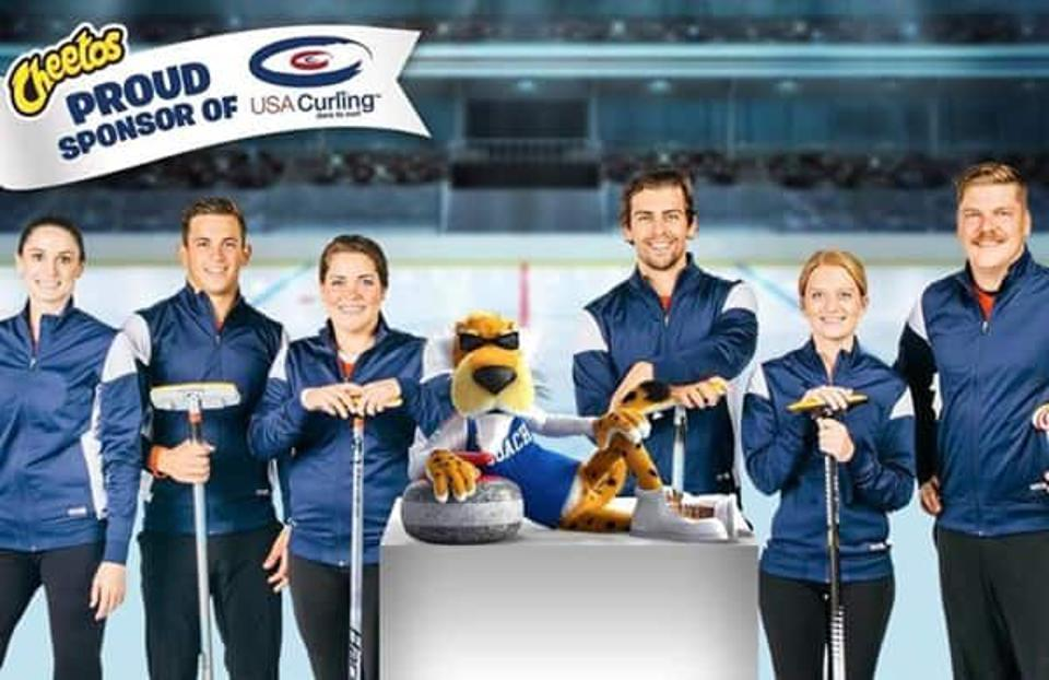 Shows Cheetos spokes character, Chester Cheetah, with the USA Olympic Curling Team Cheetos sponsored