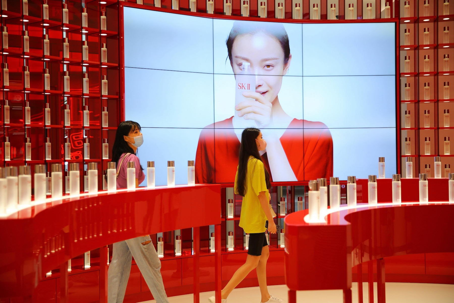 Customers purchase cosmetics at a duty-free shop in the Hainan Province of China. Getty Images.