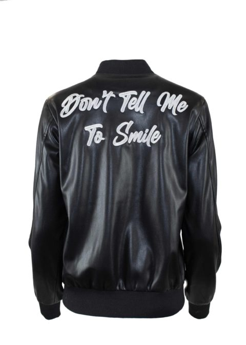 """A Hilary MacMillan jacket that says """"Don't tell me to smile"""" on the back"""