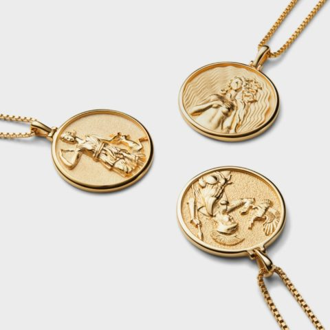international women's day products: Three gold pendants made by Awe Inspired