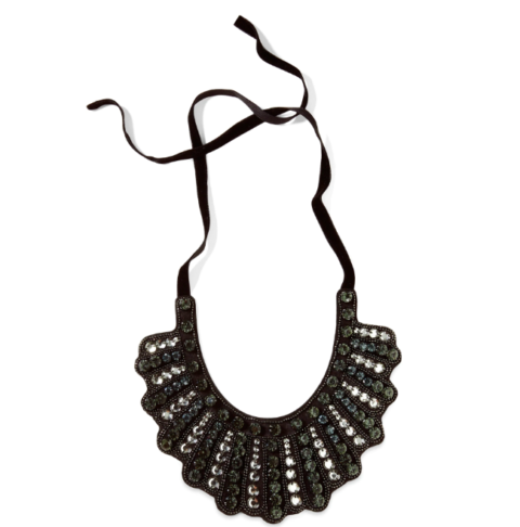 A beautiful black bib-style necklace from Banana Republic that is adorned with gems on the front