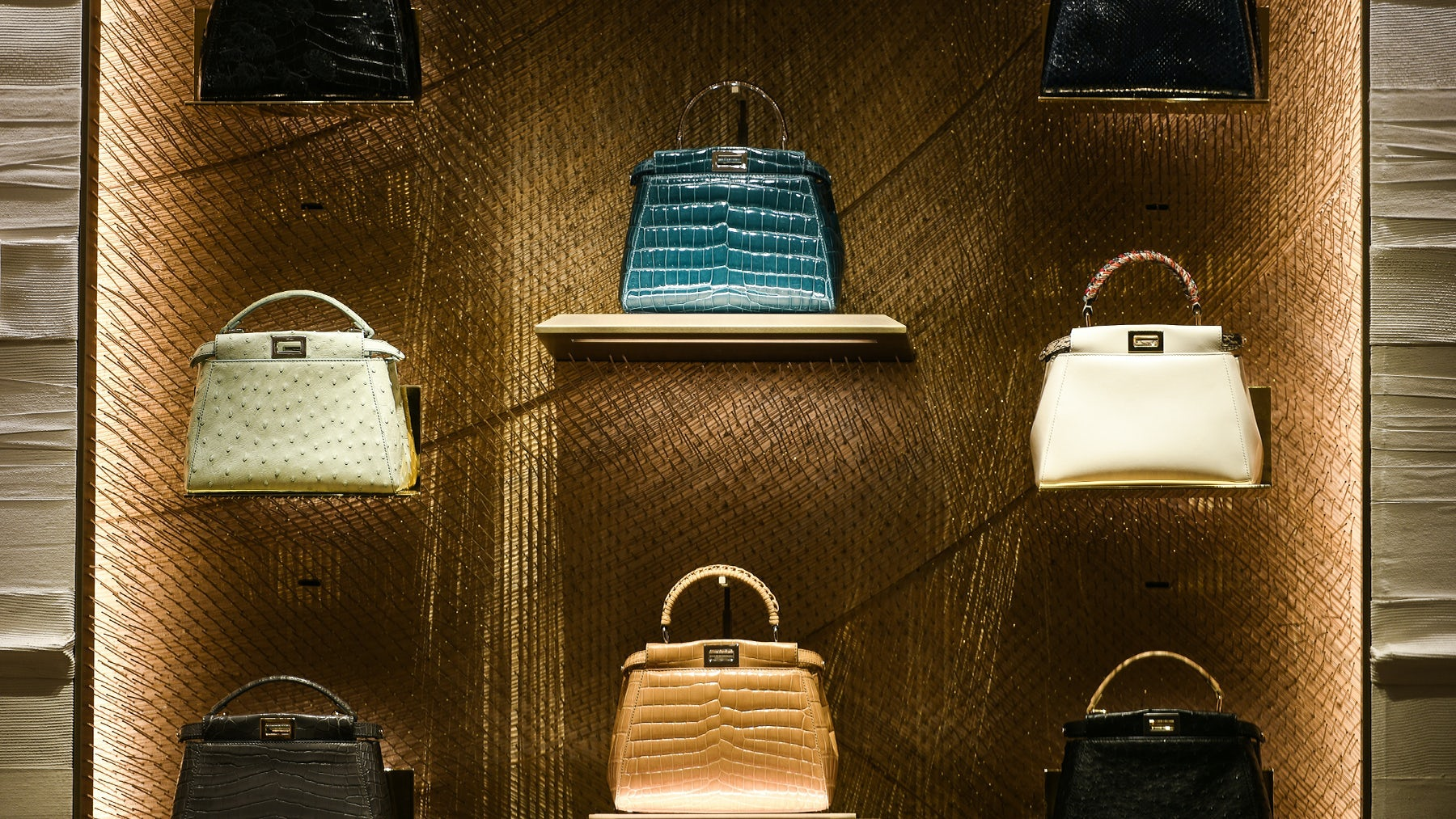 Fendi leather purses on display at a store in Paris. Shutterstock.