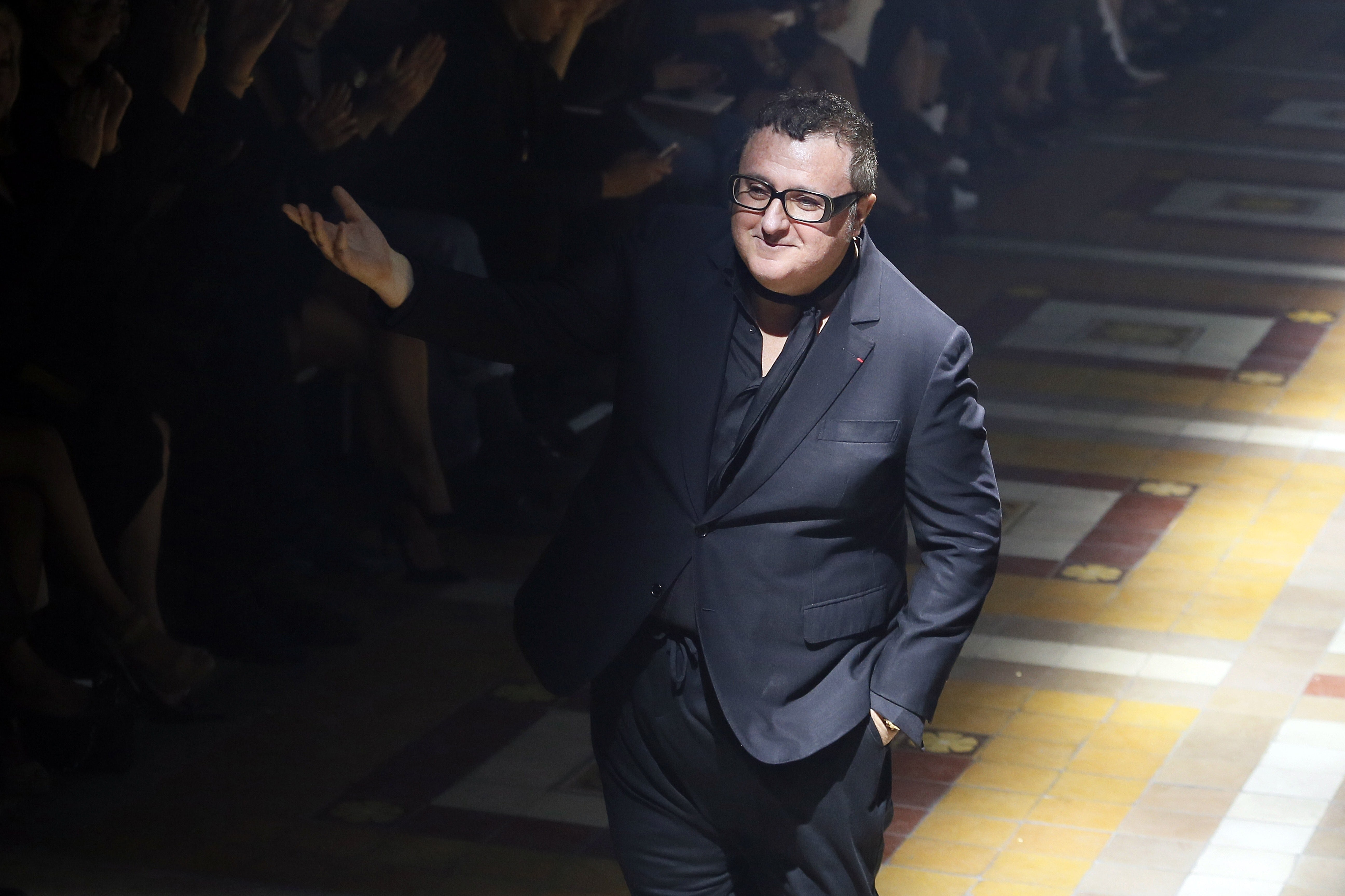 Alber Elbaz at the end of the Lanvin's 2015 Spring/Summer fashion show. Getty Images.