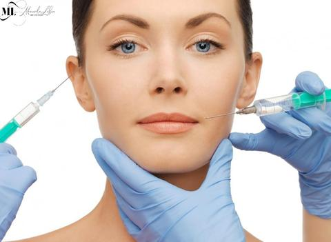 Woman getting dermal fillers on her face - ML Delicate Beauty