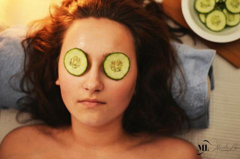 Close-up image of a woman with cucumber on her eyes - ML Delicate Beauty