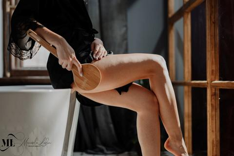 Stretch mark problems - A woman sitting on a table